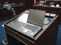 Picture of a laptop sitting on the podium open and ready for use